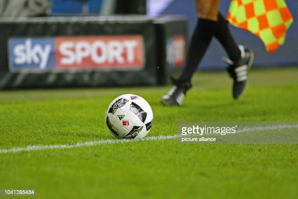 The ball rolls, watched by the linesman, on the sideline in the soccer match of RBLeipzig and Borussia Moenchengladbach on the fourth matchday of...
