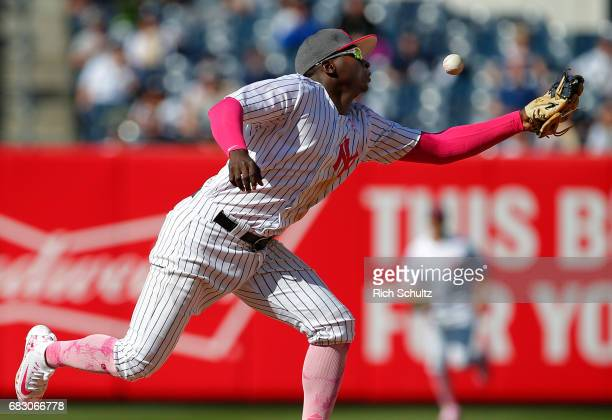 The ball sails past shortstop Didi Gregorius on a throw by Starlin Castro on a ball hit by Marwin Gonzalez of the Houston Astros during the seventh...
