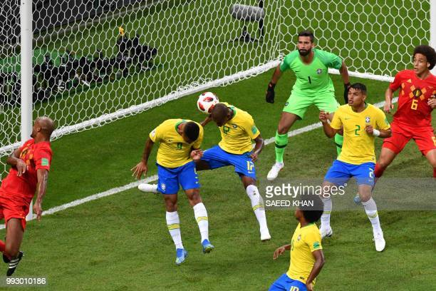 The ball shot by Belgium's defender Vincent Kompany hits Brazil's midfielder Fernandinho to score an own goal during the Russia 2018 World Cup...
