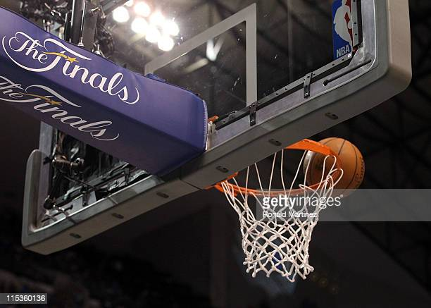 The ball sits above the rim in Game Three of the 2011 NBA Finals between the Dallas Mavericks and the Miami Heat at American Airlines Center on June...