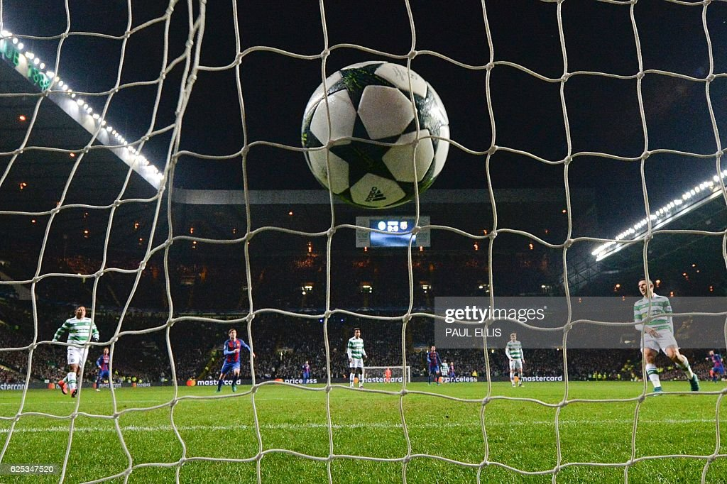 The ball slams into the back of the net after Barcelona's Argentinian striker Lionel Messi (unseen) scored a penalty for Barcelona's second goal during the UEFA Champions League group C football match between Celtic and Barcelona at Celtic Park in Glasgow on November 23, 2016. / AFP / Paul ELLIS