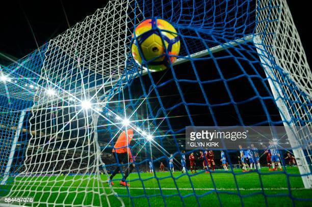 The ball slams into the back of the net from Liverpool's Brazilian midfielder Philippe Coutinho's free kick to score their fourth goal during the...