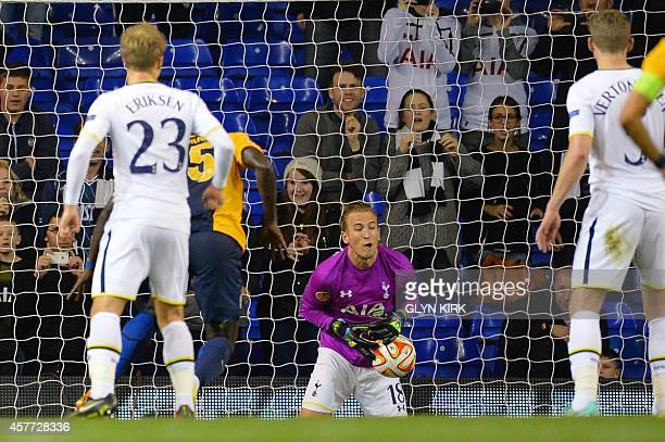 The ball slips through the fingers of Tottenham Hotspur's fillin goalkeeper English striker Harry Kane who covered goalkeeping duties after Tottenham...