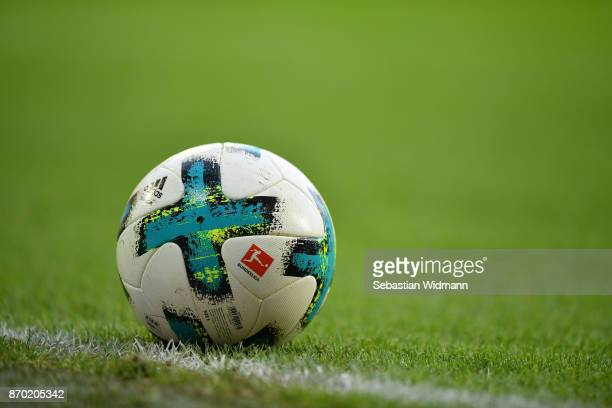 The ball with the Bundesliga logo lies on the pitch during the Bundesliga match between FC Augsburg and Bayer 04 Leverkusen at WWKArena on November 4...