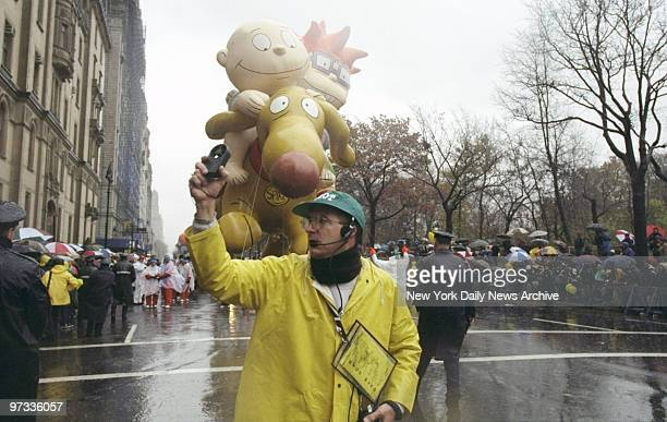 The balloon captain uses a wind gauge at intersections as Rugrats follow along at 72nd St and Central Park West during the 72nd annual Macy's...