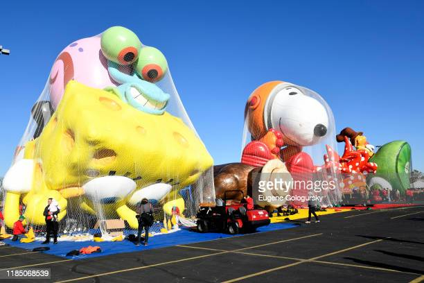 The balloons are seen being inflated as Macy's unveils new balloons for the 93rd annual Macy's Thanksgiving Day Parade at MetLife Stadium on November...