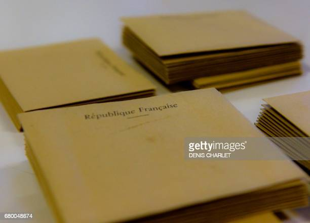 The ballots are ready to be counted at the end of the second round of the French presidential election on May 7, 2017 at a polling station in Locon....