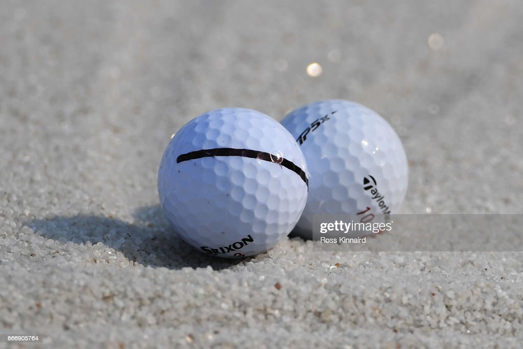 The balls of Hideki Matsuyama of Japan and Jon Rahm of Spain sit touching in a bunker on the 18th hole during the second round of the WGC - HSBC Champions at Sheshan International Golf Club on October 27, 2017 in Shanghai, China.