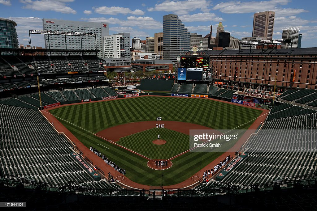 The Baltimore Orioles and Chicago White Sox stand for the nation anthem at an empty Oriole Park at Camden Yards on April 29, 2015 in Baltimore, Maryland. Due to unrest in relation to the arrest and death of Freddie Gray, the two teams played in a stadium closed to the public. Gray, 25, was arrested for possessing a switch blade knife April 12 outside the Gilmor Houses housing project on Baltimore's west side. According to his attorney, Gray died a week later in the hospital from a severe spinal cord injury he received while in police custody.