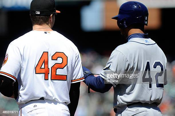 The Baltimore Orioles and the Tampa Bay Rays wear jersey number 42 in honor of Jackie Robinson Day during the game at Oriole Park at Camden Yards on...