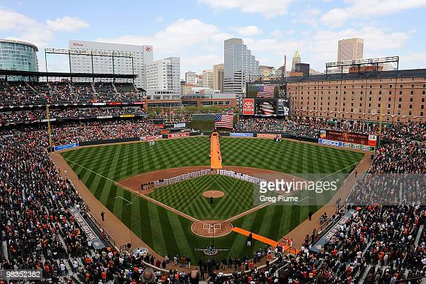 The Baltimore Orioles and the Toronto Blue Jays line up for the National Anthem on Opening Day at Camden Yards on April 9, 2010 in Baltimore,...