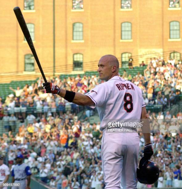 The Baltimore Orioles' Cal Ripken, Jr., acknowledges the crowd's standing ovation before his first at bat during the game against the Toronto Blue...