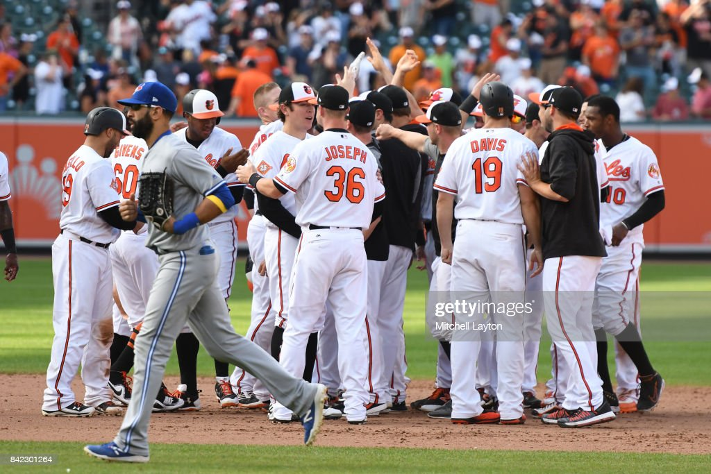 The Baltimore Orioles celebrate a Mark Trumbo #45 (not pictured) walk single to score Jonathan Schoop #6 (not pictured) in the 12th inning during a baseball game against the Toronto Blue Jays at Oriole Park at Camden Yards on September 3, 2017 in Baltimore, Maryland.