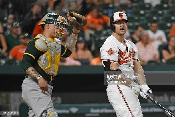 The Baltimore Orioles' Chris Davis right strikes out in front of Oakland Athletics catcher Bruce Maxwell to end the game at Oriole Park at Camden...