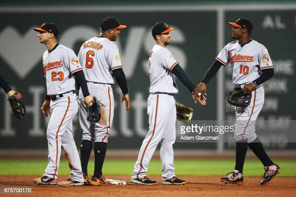 The Baltimore Orioles high five each other after their victory over the Boston Red Sox at Fenway Park on May 1 2017 in Boston Massachusetts