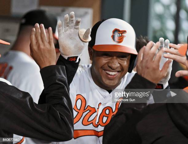 The Baltimore Orioles' Jonathan Schoop celebrates in the dugout after his solo home run against the Seattle Mariners in the first inning at Oriole...