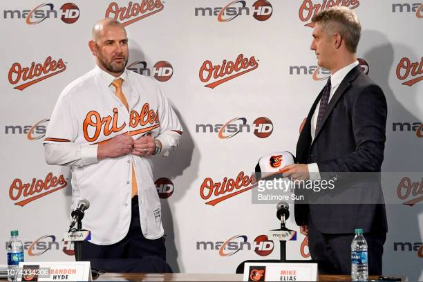 The Baltimore Orioles' new manager Brandon Hyde puts on an Orioles uniform during his introduction by General Manager Mike Elias at a press...