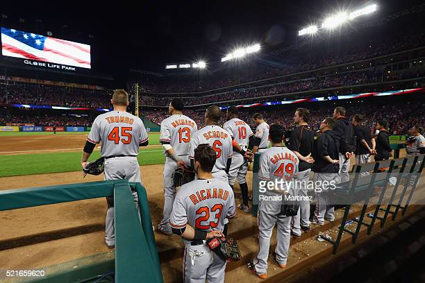 The Baltimore Orioles stand during the singing of 'God Bless America' during play against the Texas Rangers at Globe Life Park in Arlington on April...