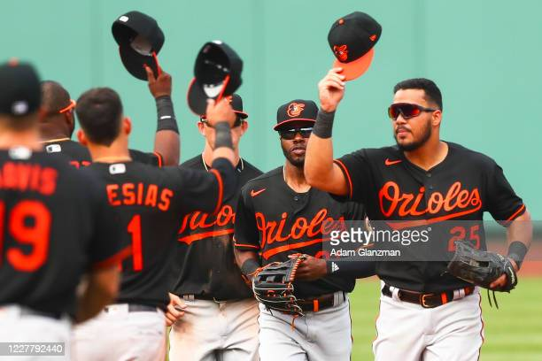 The Baltimore Orioles tap hats after defeating the Boston Red Sox at Fenway Park on July 26 2020 in Boston Massachusetts
