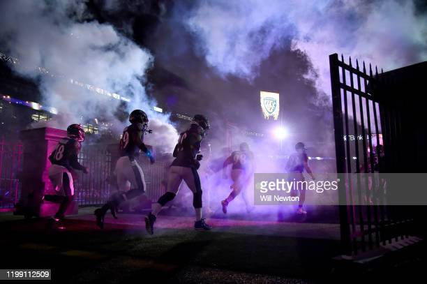 The Baltimore Ravens are introduced prior to the AFC Divisional Playoff game against the Tennessee Titans at MT Bank Stadium on January 11 2020 in...