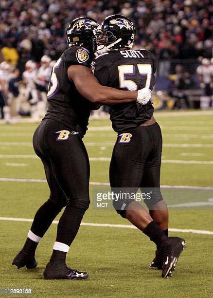 The Baltimore Ravens Bart Scott is held back by teammate Terrell Suggs as he yells at an offical after the Ravens gave up the gamewinning touchdown...