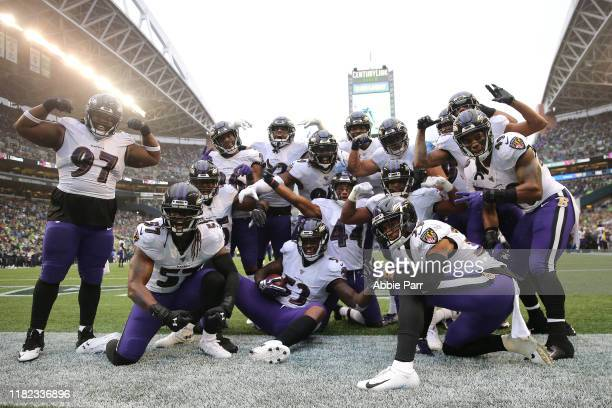 The Baltimore Ravens celebrate a 18 yard fumble recovery touchdown by Marlon Humphrey of the Baltimore Ravens in the fourth quarter against the...