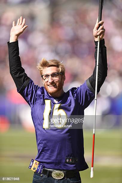 The Baltimore Ravens celebrate paralympian gold metal swimmer Brad Snyder during a football game against the Washington Redskins at MT Bank Stadium...