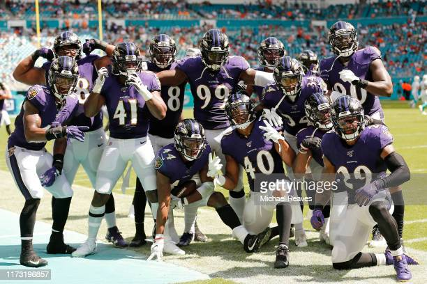 The Baltimore Ravens defense celebrates after a interception by Marlon Humphrey against the Miami Dolphins during the fourth quarter at Hard Rock...