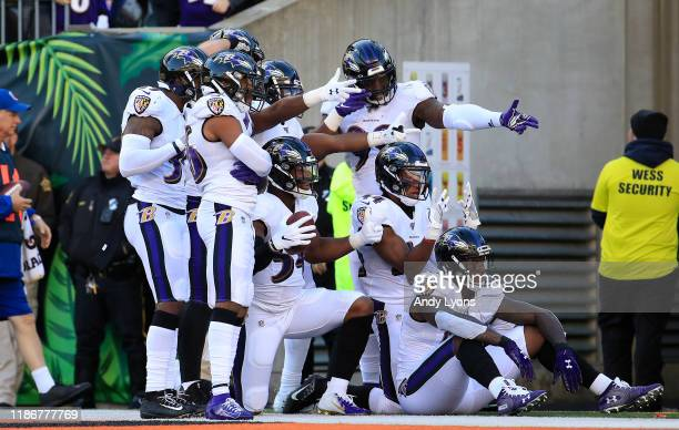 The Baltimore Ravens defense poses for the cameras after a fumble was returned for a touchdown against the Cincinnati Bengals at Paul Brown Stadium...