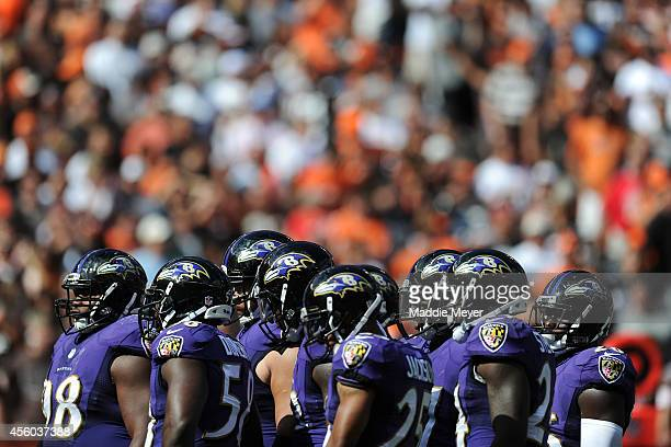 The Baltimore Ravens defensive line stand together between plays during the second half against the Cleveland Browns at FirstEnergy Stadium on...