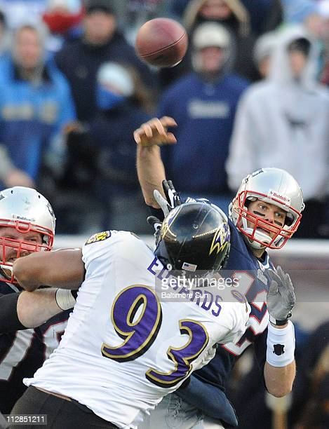 The Baltimore Ravens' Dwan Edwards gets and hand on New England Patriots quarterback Tom Brady during a pass attempt in the third quarter of an AFC...