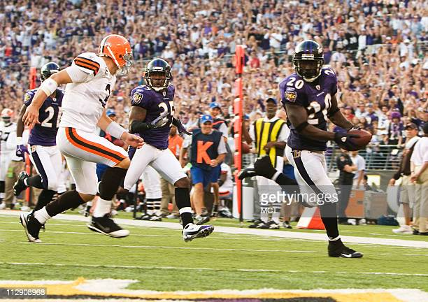 The Baltimore Raven's Ed Reed pulls away from Cleveland Browns quarterback Derek Anderson on his way to returning an interception for a touchdown in...
