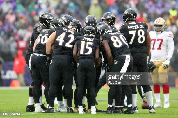 The Baltimore Ravens offense huddles against the San Francisco 49ers defense at M&T Bank Stadium on December 01, 2019 in Baltimore, Maryland.