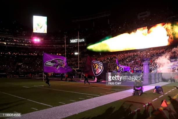 The Baltimore Ravens take the field before the start of their AFC Divisional Playoff game against the Tennessee Titans at MT Bank Stadium on January...