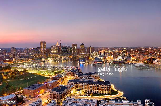 the baltimore skyline and inner harbor, evening - baltimore maryland stock pictures, royalty-free photos & images