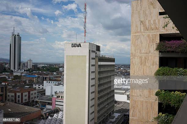 The Banco Bilbao Vizcaya Argentaria SA logo is displayed on a building in the financial district of Cali Colombia on Wednesday Aug 12 2015 Colombia's...