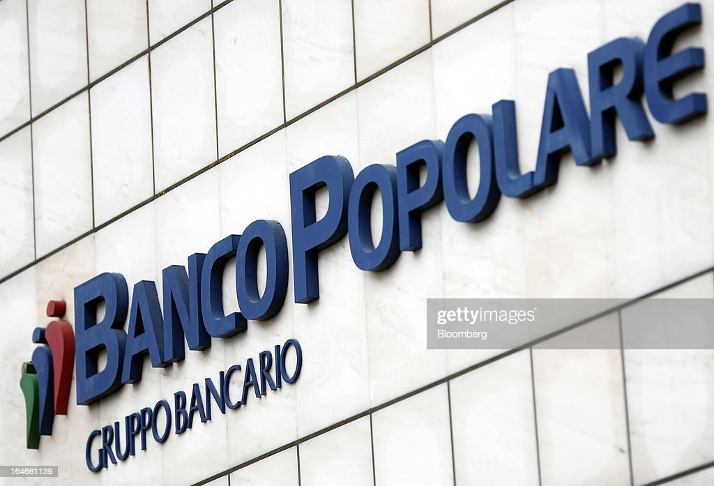 The Banco Popolare SC logo is displayed outside the company's headquarters in Verona, Italy, on Monday, March 25, 2013. Italy's economy remains mired in its longest recession in two decades and a month-old political impasse threatens to increase sovereign-debt yields and bank funding costs. Photographer Alessia Pierdomenico/Bloomberg via Getty Images