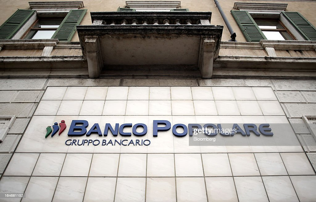 The Banco Popolare SC logo sits on a sign outside the company's headquarters in Verona, Italy, on Monday, March 25, 2013. Italy's economy remains mired in its longest recession in two decades and a month-old political impasse threatens to increase sovereign-debt yields and bank funding costs. Photographer Alessia Pierdomenico/Bloomberg via Getty Images