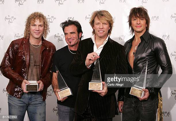 The Band Bon Jovi poses in the press room with their Merit Award at the 32nd Annual 'American Music Awards' at the Shrine Auditorium November 14 2004...