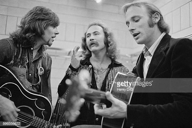 The band Crosby Stills Nash rehearse backstage before a concert From left to right Graham Nash David Crosby and Stephen Stills