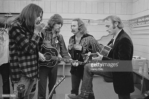 The band Crosby Stills Nash Young rehearse backstage before a concert From left to right Neil Young Graham Nash David Crosby and Stephen Stills