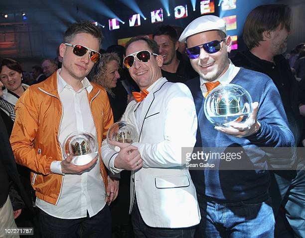 The band Fettes Brot celebrate after winning the Best Band Award and Best Live Act Award at the '1Live Krone' Music Awards on December 2, 2010 in...