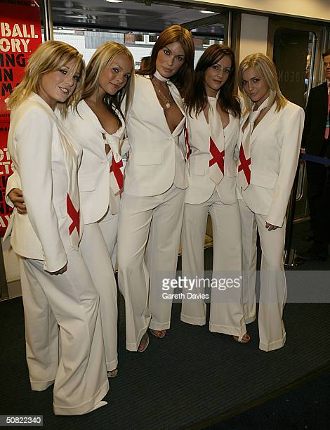 The band Glam'R'Us group members Elle Taylor Holly McGuire DJ Sassy Sarah Jane Clarke and Kayleigh Pearson attend the UK Premiere of The Football...