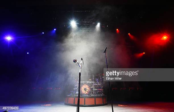 The band Godsmack keeps the stage lit with the blue, white and red colors of the French flag in a show of solidarity with France before the group's...