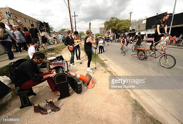The band Hands Teeth from Toronto Canada performs on 6th Street during the 2012 SXSW Music Film Interactive Festival on March 16 2012 in Austin Texas
