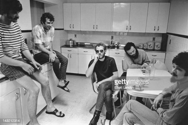 The Band in the kitchen at 'Big Pink' a house shared by Rick Danko Richard Manuel and Garth Hudson in West Saugerties New York Easter Sunday 1968...
