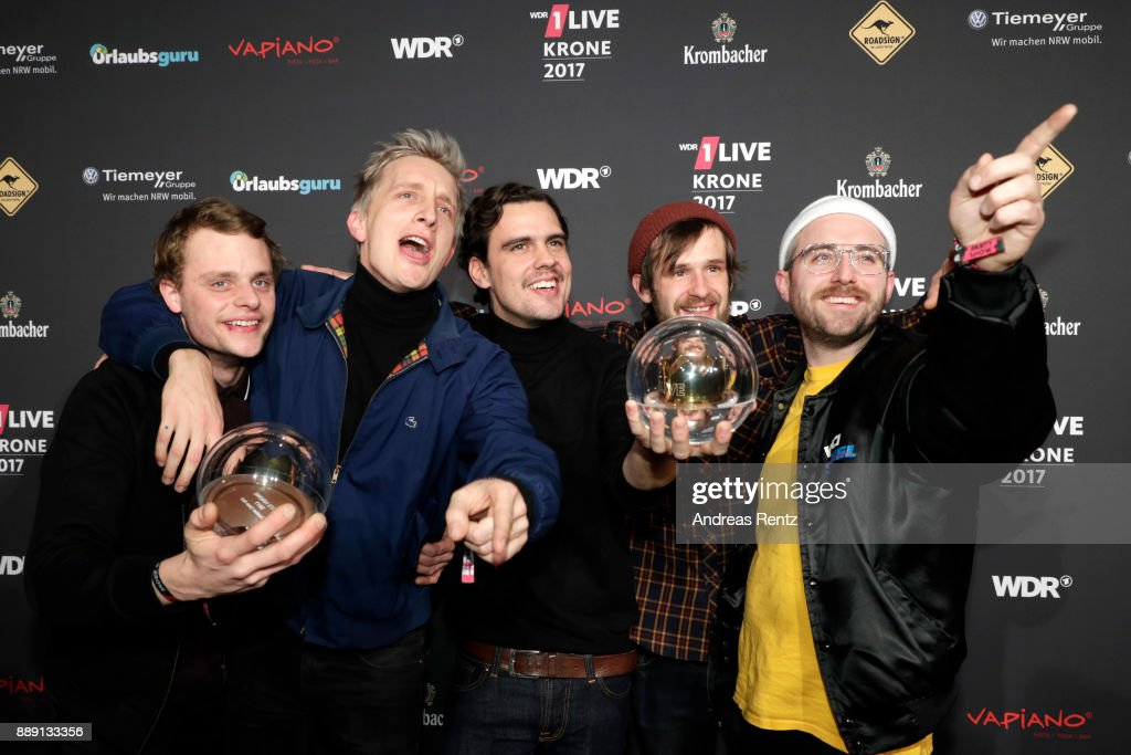 The band 'Kraftklub' celebrate their award during the 1Live Krone radio award at Jahrhunderthalle on December 07, 2017 in Bochum, Germany.