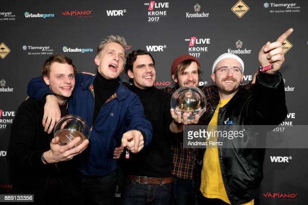 The band 'Kraftklub' celebrate their award during the 1Live Krone radio award at Jahrhunderthalle on December 07 2017 in Bochum Germany