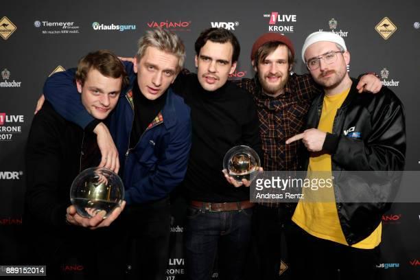 The band 'Kraftklub' celebrate their award during the 1Live Krone radio award at Jahrhunderthalle on December 07 2017 in Bochum Germany