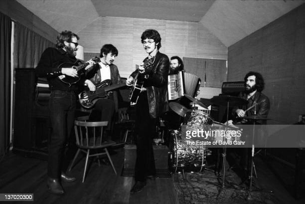 The Band lr Levon Helm Rick Danko Robbie Robertson Garth Hudson and Richard Manual rehearse in December 1969 in Woodstock New York